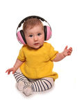 Baby girl wearing pink ear defenders Royalty Free Stock Image