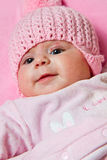 Baby girl is wearing a pink hat Stock Photo