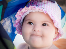 Baby girl wearing a pink hat Stock Photos