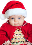 Baby girl wearing a Santa Claus hat Stock Photo