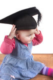 Baby girl wearing university graduation hat Royalty Free Stock Photo