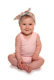 Baby girl wearing vintage floral headband. Cutout Stock Images