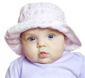 Baby girl wearing a violet suit and hat Royalty Free Stock Photo
