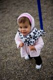 Baby girl wearing winter coat and scarf Royalty Free Stock Photography