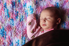 Baby Girl. 2 week old baby girl lying on a soft blanket/pillow -- image taken indoors using natural light Royalty Free Stock Images