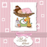 Baby girl on on weighing scale Stock Images
