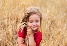 BAby girl at the wheat field Royalty Free Stock Photography