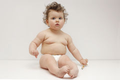 Baby girl on white background stock image