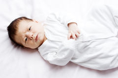 Baby girl in white bed Stock Photo