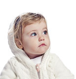 Baby girl in a white cap stock photography