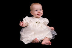 Baby girl in a white dress Royalty Free Stock Images