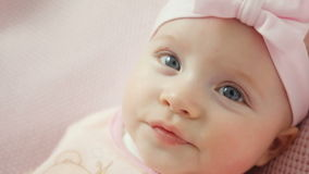 Baby girl in white dress and headband stock footage