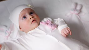 Baby girl white knitted jacket with pink rabbit stock video footage