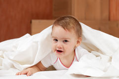 Baby girl  on white sheet Royalty Free Stock Photography