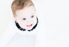 Baby girl in a white shirt with plaid black collar Stock Photography
