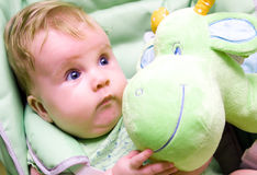 Baby girl wih teddy Stock Photos