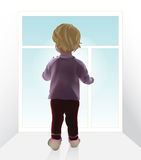 Baby girl by the window Stock Photo