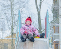 Baby girl winter on icy hill Stock Image
