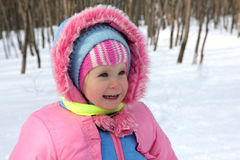 Baby girl in winter park Royalty Free Stock Photos