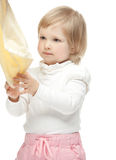 The baby girl is wiping hands. White background Stock Photography