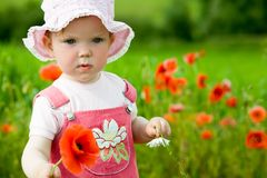 Baby-girl With Red Flower Royalty Free Stock Photography