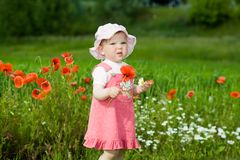 Baby-girl With Red Flower Royalty Free Stock Photo