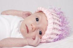 Baby girl in woolen hat. Portrait of cute baby girl in pink woolen hat stock photos