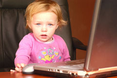 Baby girl worker. Just working away, small child in office royalty free stock images