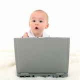 Baby Girl Working On Laptop Royalty Free Stock Photography