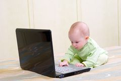 Baby girl  working on laptop Stock Images
