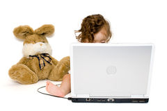 Baby girl working with laptop, isolated Royalty Free Stock Photo