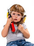 Baby girl with working tool Royalty Free Stock Photos