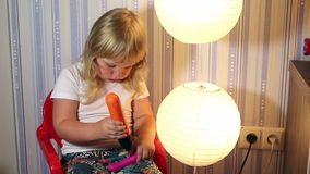 Baby girl with working tool screwdriver stock footage