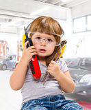 Baby girl with working tool Royalty Free Stock Photo