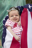 Baby  girl wrapped in American flag. Newborn baby (Sophia Larson) wrapped in American flag was born on October 16th, the birthday of the 300 Millionth American Stock Photography