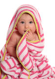 Baby girl wrapped in pink towel. Cutout Stock Photography