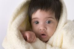 Baby girl wrapped in towel Stock Image