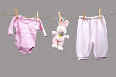 Baby girl y clothes   on the clothesline Stock Photo