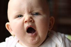 Baby girl yawning Stock Images