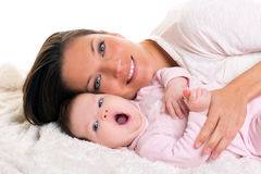 Baby girl yawning open mouth with mother care near Royalty Free Stock Photo