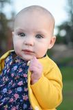 Baby Girl in Yellow Stock Photography
