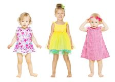 Baby Girls in Dress, Kids Group, Toddler Children. Isolated over White background, one three years old Royalty Free Stock Images