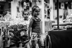 Baby Girls On The Market At Night Royalty Free Stock Photography