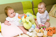 Baby girls play stock photo