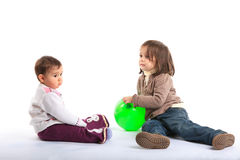 Baby girls playing Stock Images