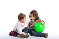 Baby girls playing Stock Image