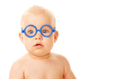 Baby in glasses looking at something Royalty Free Stock Photos
