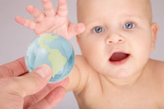 Baby & globe Royalty Free Stock Image