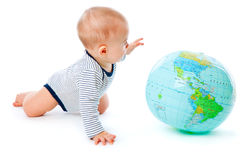 Baby and globe. Isolated on white background Stock Photos