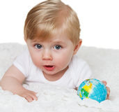 Baby with globe. Stock Photography